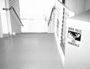 "Stairway with ""use handrail"" sign"